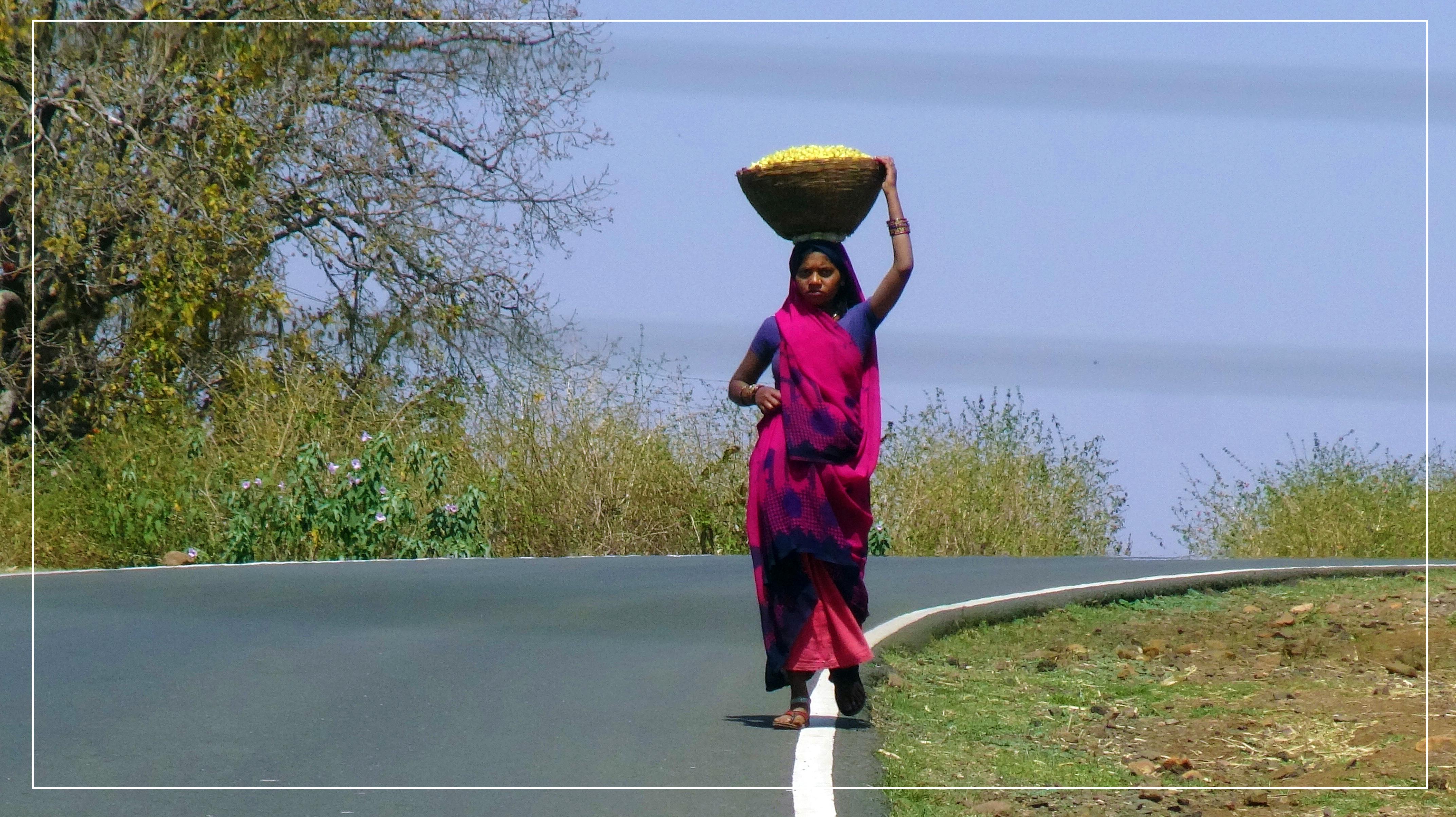 Tribal Women Carrying Mahua Flower